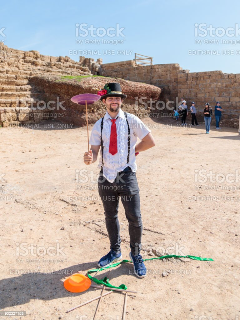 A juggler - participant of the Purim festival shows performance for visitors in Caesarea, Israel stock photo