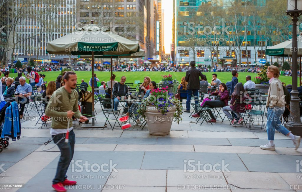 A Juggler Practicing Diabolo at Bryant Park Terrace At Sunset stock photo