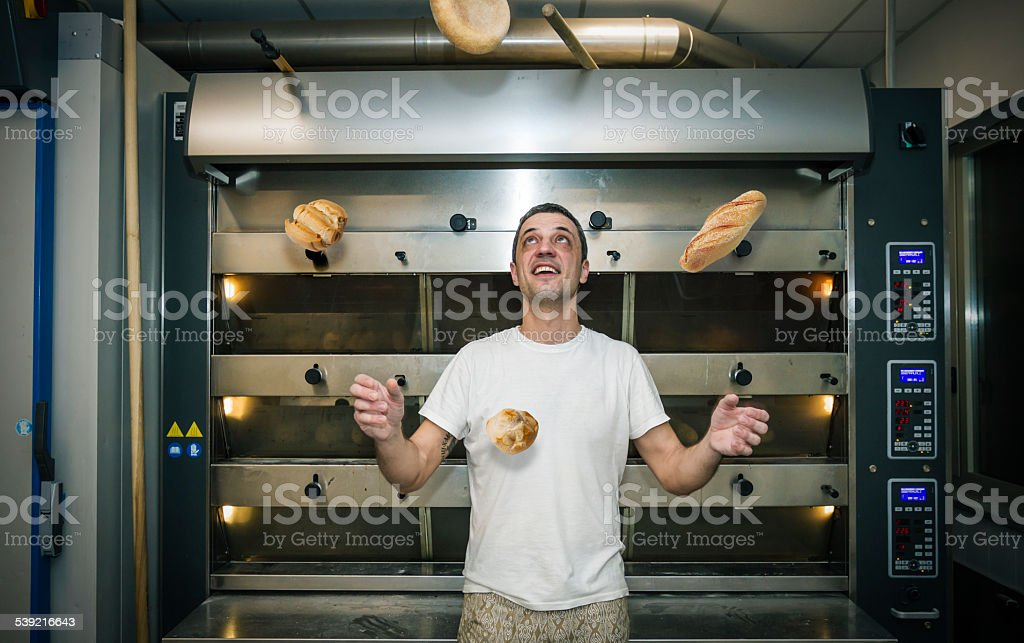 Juggler with breads stock photo