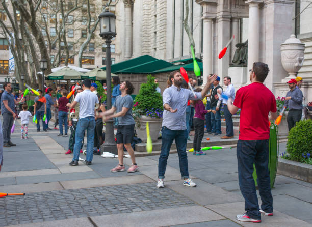 Jugglers and Spinners Practicing at Bryant Park on a Spring Evening