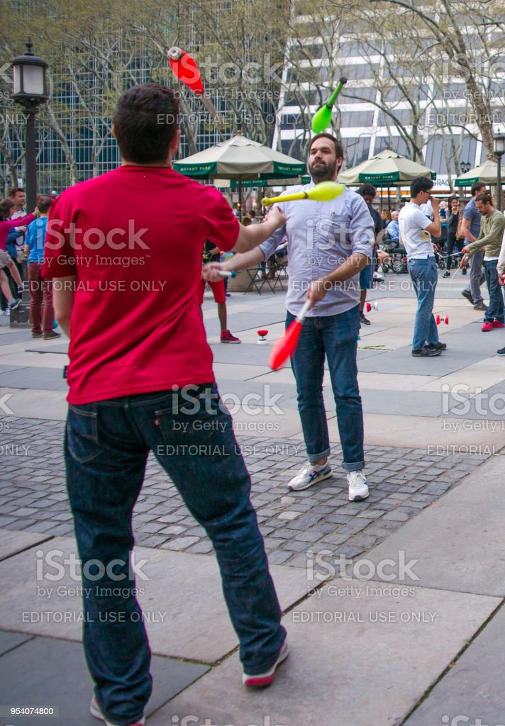 Jugglers and Spinners Practicing at Bryant Park on a Spring Evening stock photo