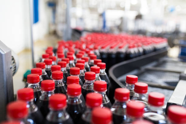juice and soda production factory - bottling plant stock photos and pictures