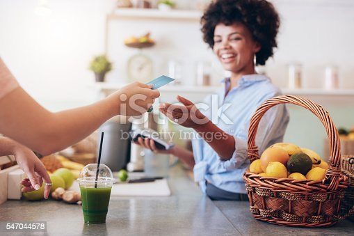 istock Juice bar owner taking payment from customer 547044578