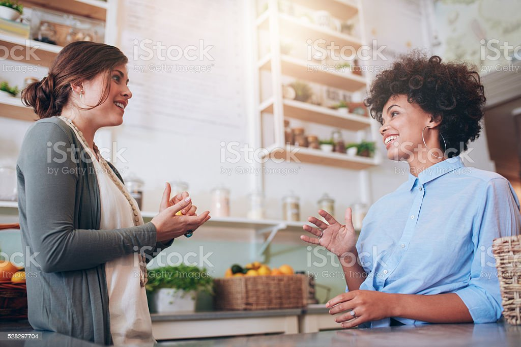 Juice bar partners discussing new business stock photo