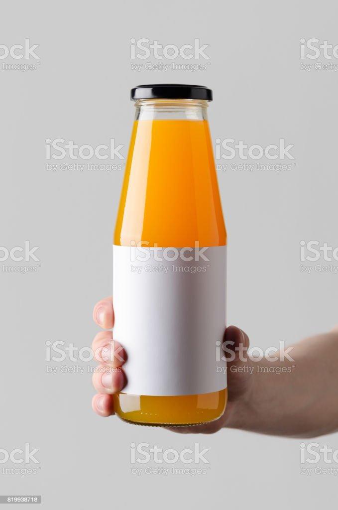 juice bottle mockup blank label male hands holding a juice bottle on