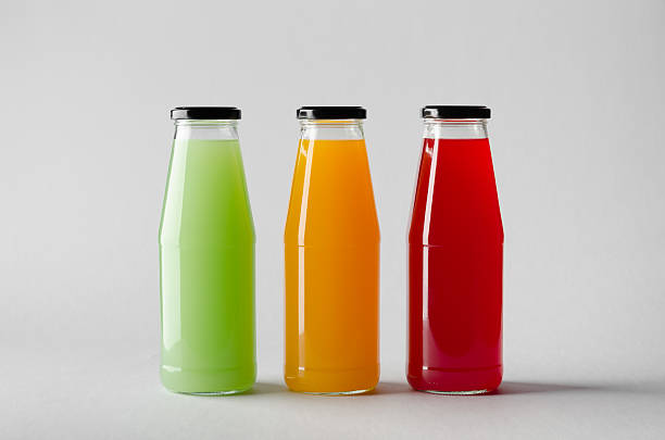 juice bottle mock-up - three bottles - etiketten vorlagen stock-fotos und bilder