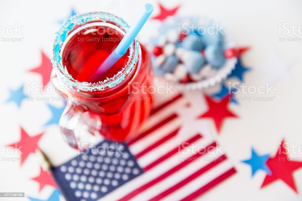 juice glass and american flag on independence day stock photo
