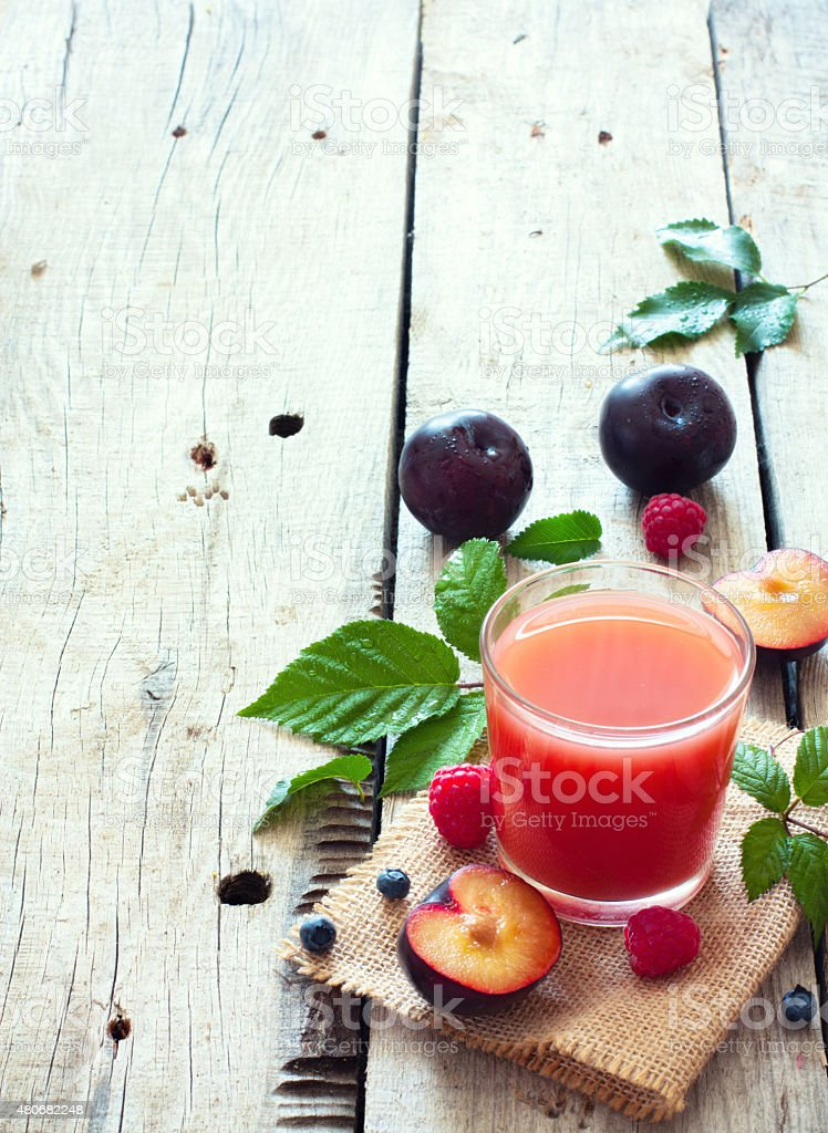 Juice of plums and berries stock photo