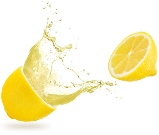 レモンからこぼれるジュース - レモン ストックフォトと画像