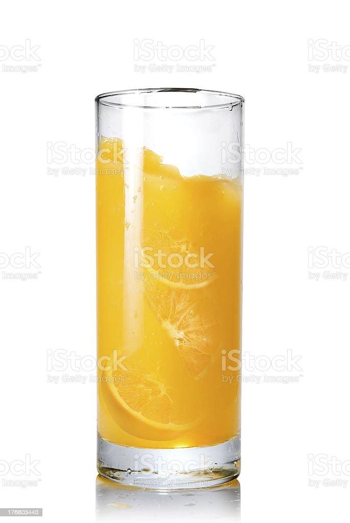 Juice splash in glass with slices of orange royalty-free stock photo