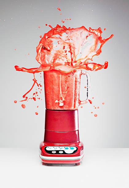 Juice splashing from blender  blender stock pictures, royalty-free photos & images