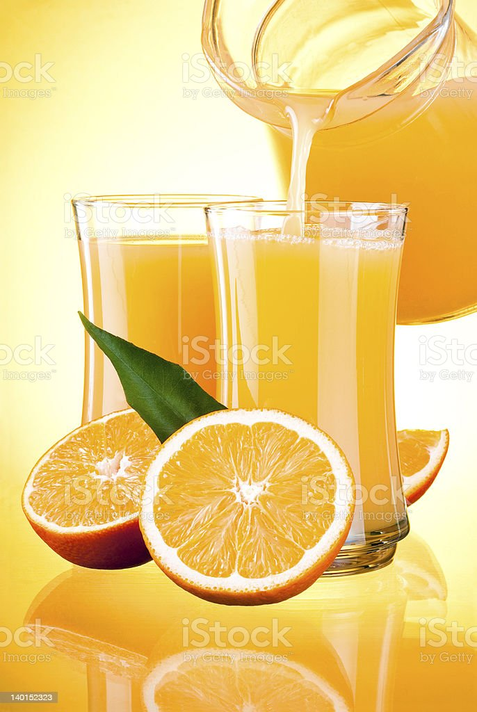 Juice to pour from pitcher, Oranges with leaves royalty-free stock photo