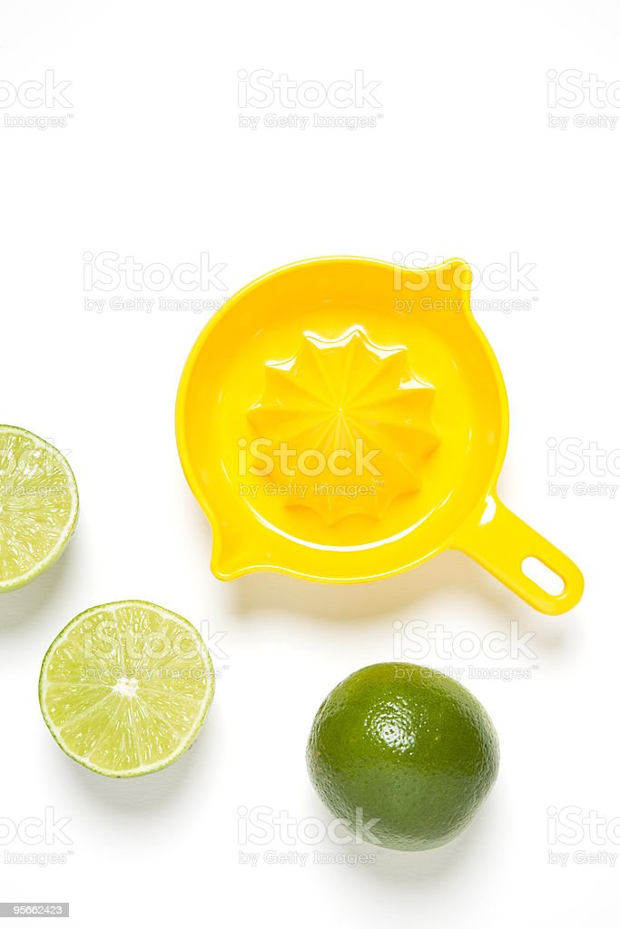 Juicer and Limes stock photo
