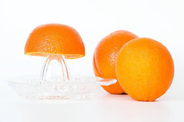 Saftpresse und Orangen – Foto