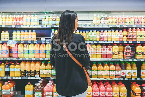 Rearview shot of a young woman shopping in a grocery store