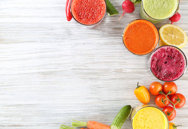 juices juices vegetable juice stock pictures, royalty-free photos & images