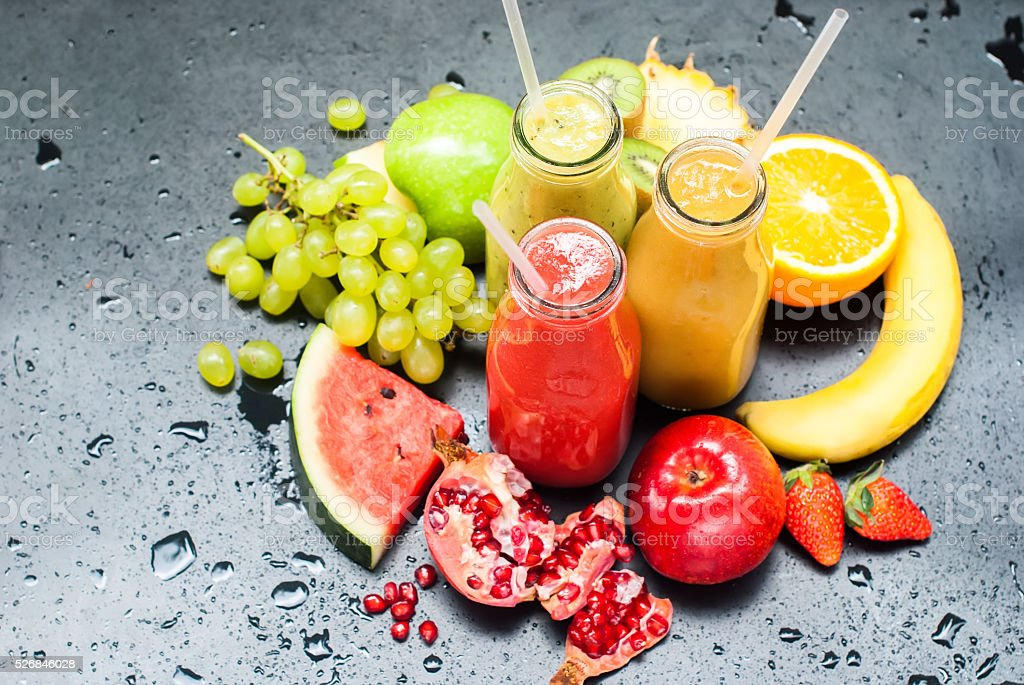 Juices Smoothie Red Green Orange Fruits Tropical stock photo