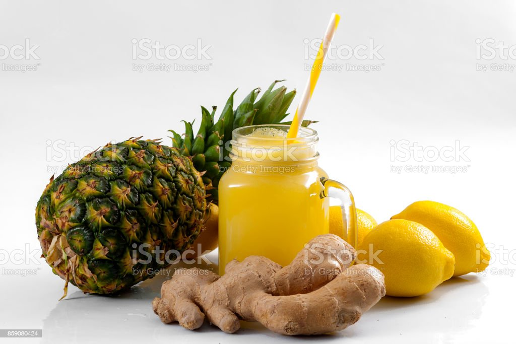 Juicing raw fruits and vegetables and juice extractor recipes Juicing raw fruits and vegetables and juice extractor recipes concept with pineapple, lemon and ginger, the ingredients for a detox smoothie that helps with inflammation and digestion; Anti-inflammatory Stock Photo