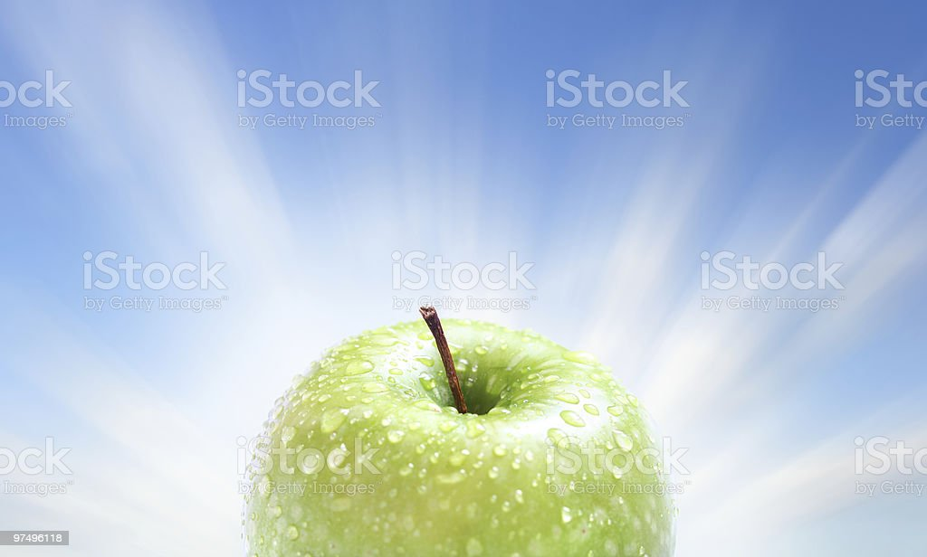 juicy apple on blue royalty-free stock photo