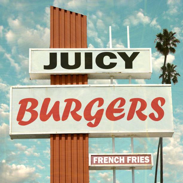 juicy burgers sign stock photo