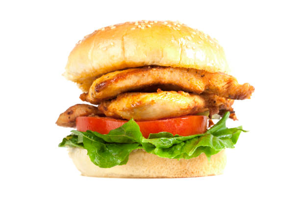 Juicy Chicken Burger A Juicy Chicken Burger with tomato and lettuce. Isolated on white. XXL file size available.  grilled chicken breast stock pictures, royalty-free photos & images