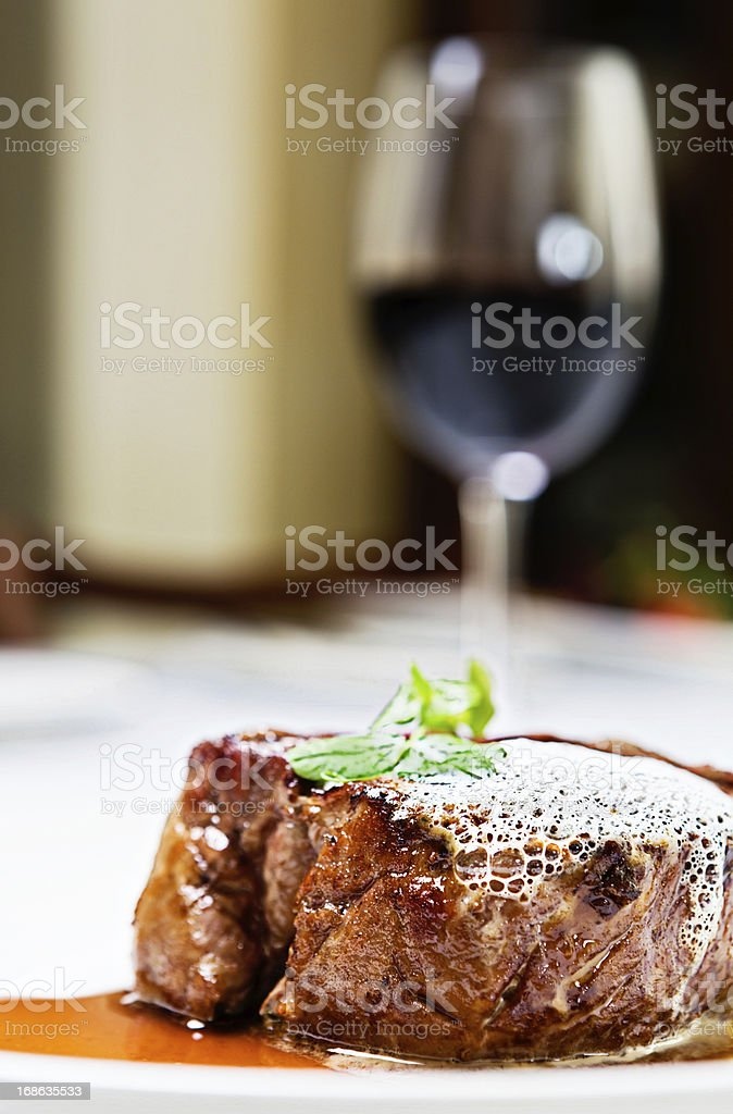 Juicy fillet steak and a glass of good red wine stock photo