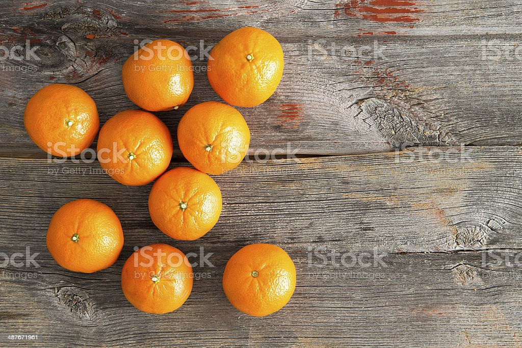 Juicy fresh clementines on a rustic wooden table stock photo