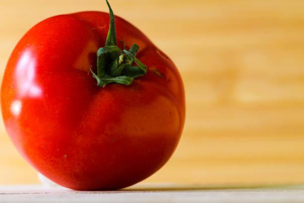 Juicy fresh red tomato stock photo