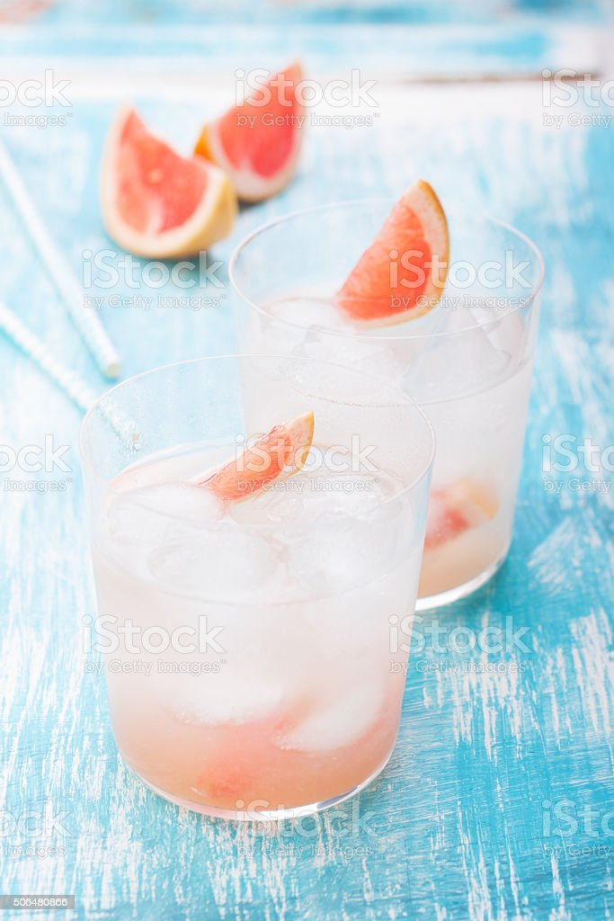 Juicy grapefruit cocktail with ice and alcohol stock photo