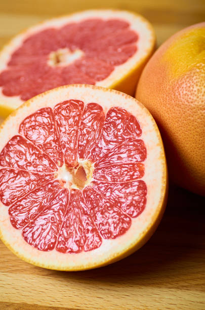 juicy grapefruit slices close up on a board