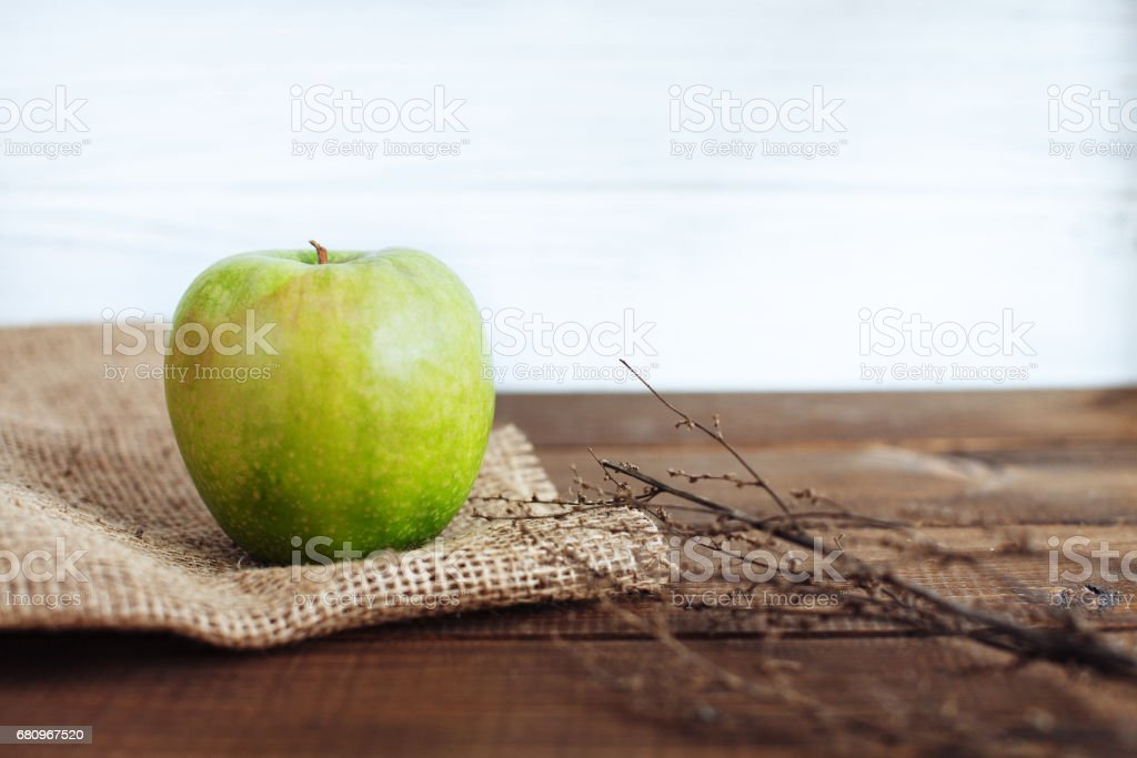 Juicy green apple on the table. The concept of healthy eating and vegetarianism. royalty-free stock photo