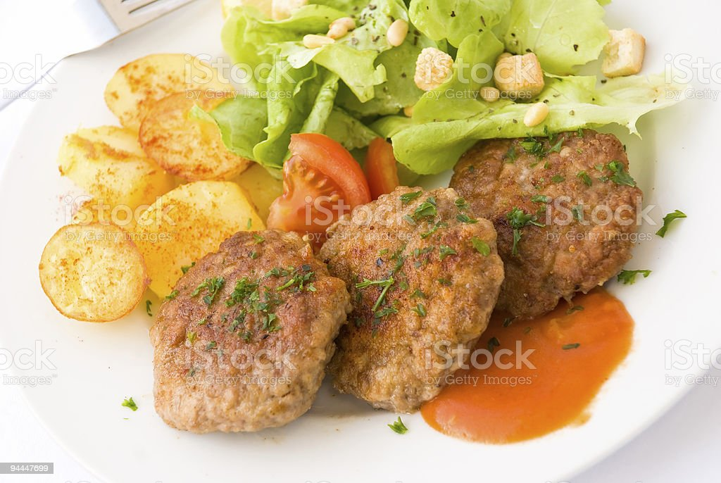 Juicy Hamburger with fried potatoes royalty-free stock photo