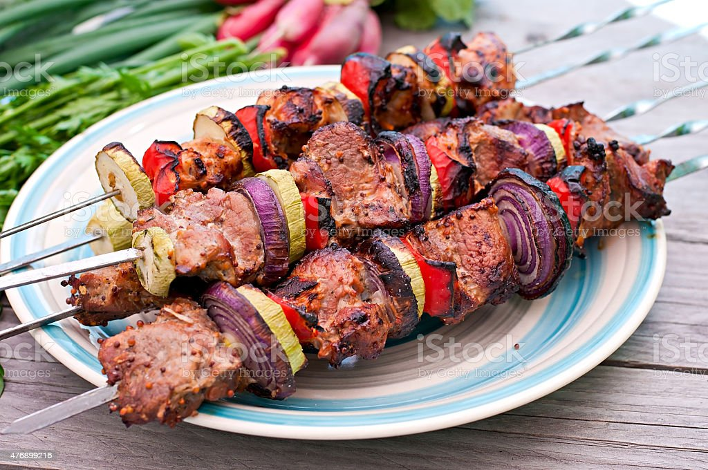 Juicy kebabs and grilled vegetables stock photo