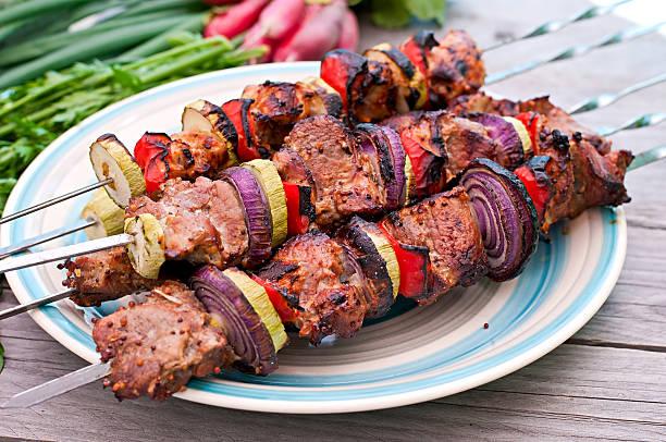 Juicy kebabs and grilled vegetables stock photo