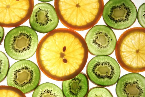 juicy kiwi and orange slices background