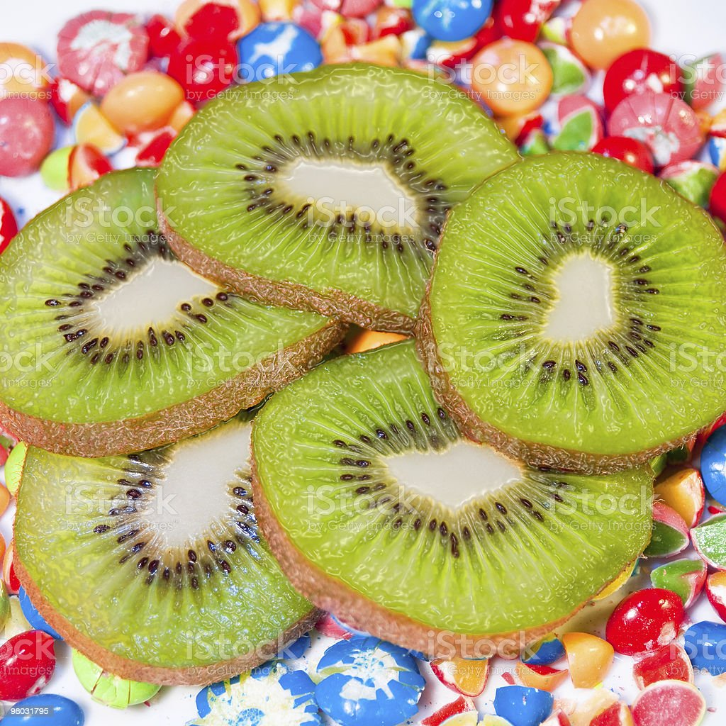 Juicy kiwi slices on colorful candy royalty-free stock photo