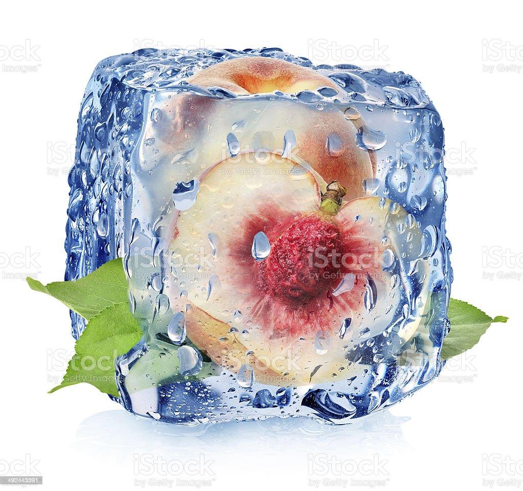 Juicy peach in ice cube stock photo