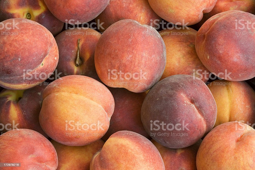 Juicy peaches at the food market royalty-free stock photo