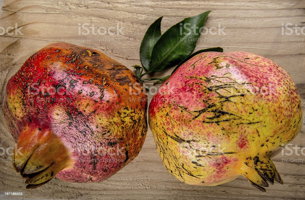 Juicy pomegranates on wood royalty-free stock photo