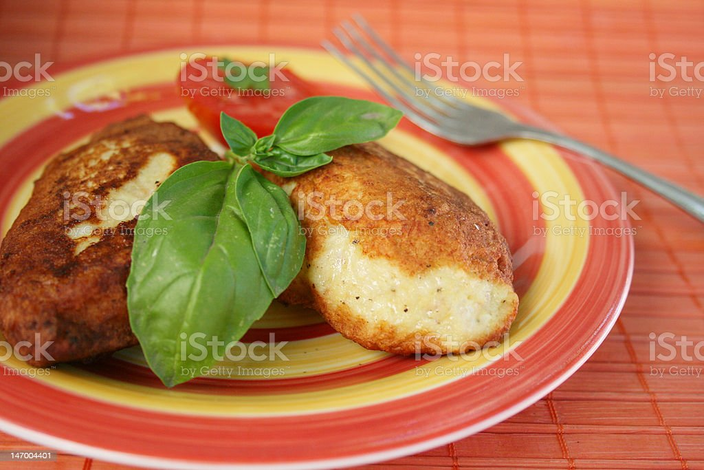 Juicy pork chops with a garnish from greens. royalty-free stock photo