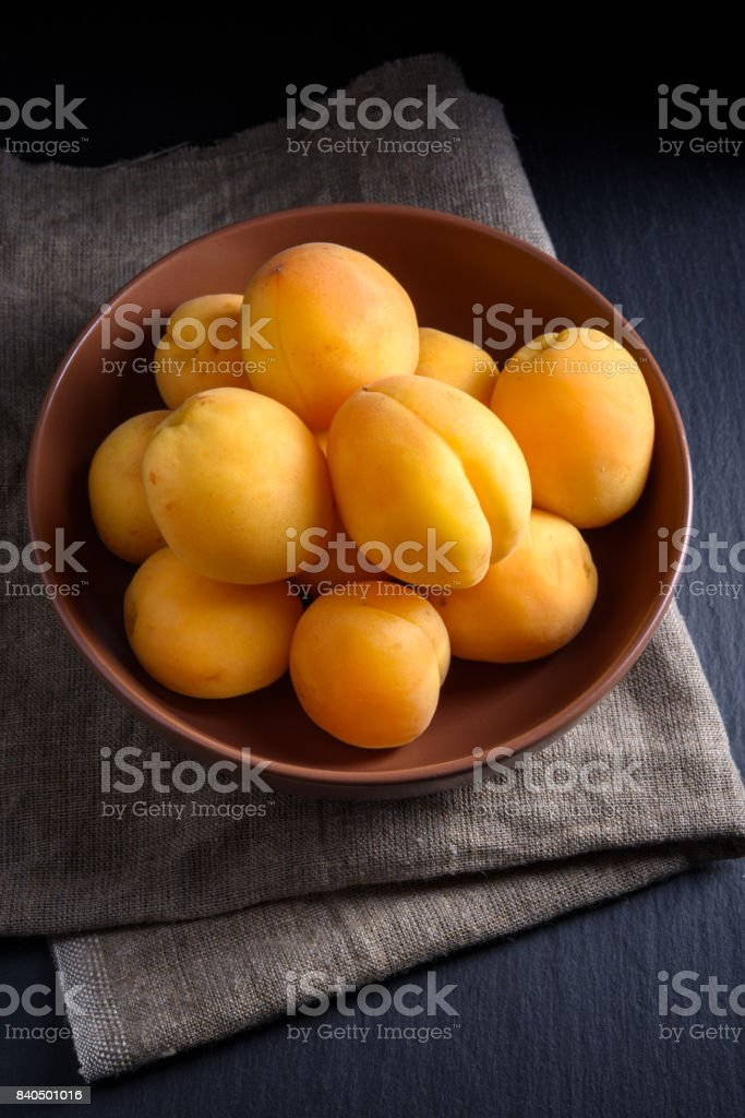 Juicy ripe apricot on dark background stock photo