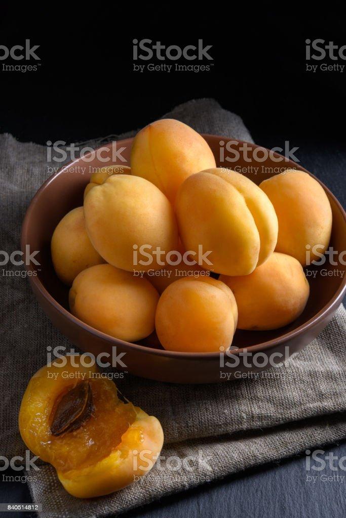 Juicy riped apricot on dark background stock photo