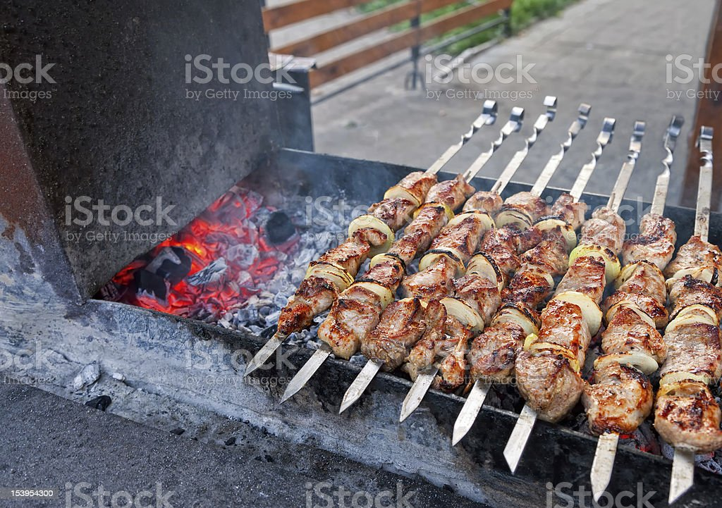Juicy slices of meat  prepare on fire royalty-free stock photo