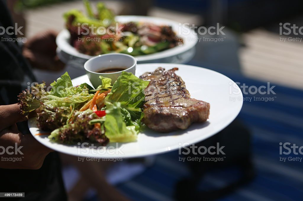 Juicy steak and fresh vegetable salad royalty-free stock photo