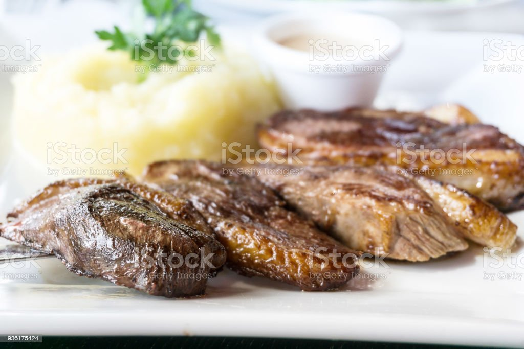 juicy steak veal beef meat with tomato and potatoes stock photo