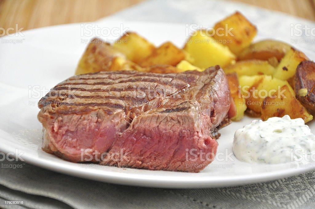 juicy steak with potato wedges royalty-free stock photo