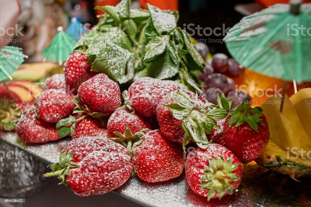 Juicy sweet berries in powdered sugar - Royalty-free Berry Stock Photo