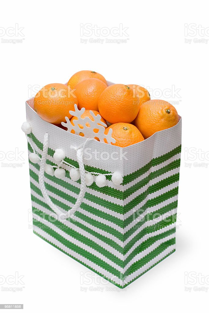 juicy tangerines in the gift packet royalty-free stock photo