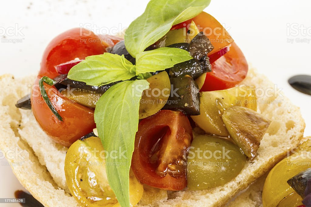 juicy tomatoes on fresh bread, pesto as topping royalty-free stock photo