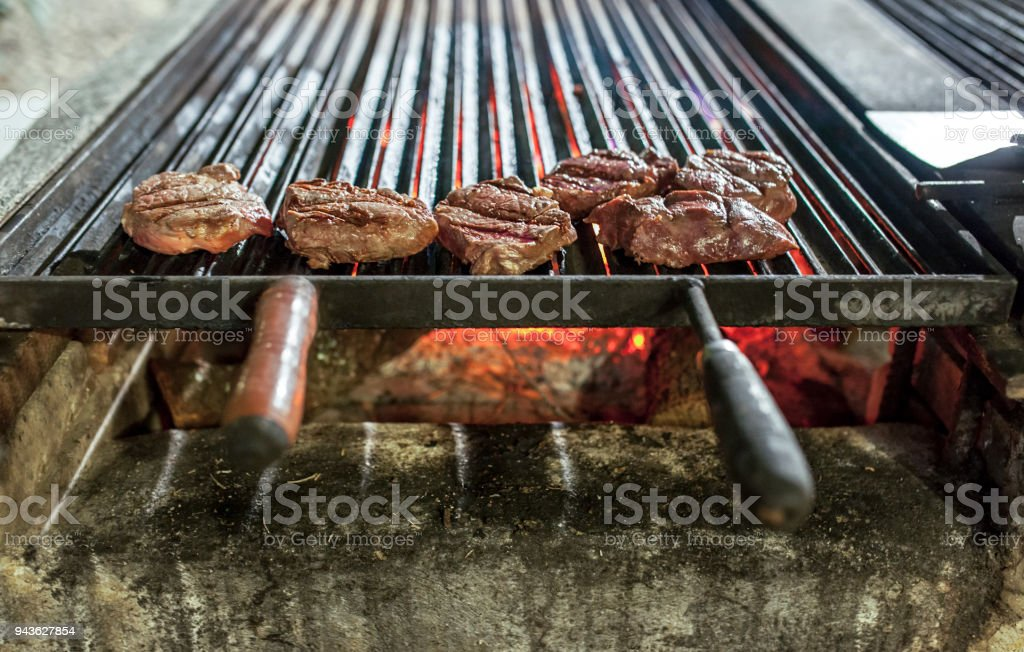 Juicy veal loin pieces on grill stock photo